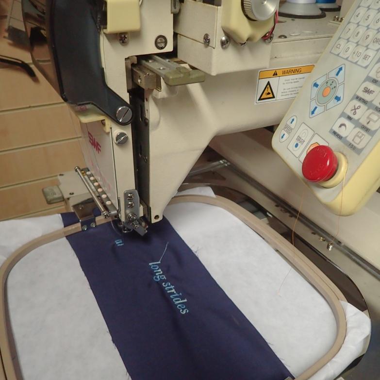Stitching the poem on the indigo cloth