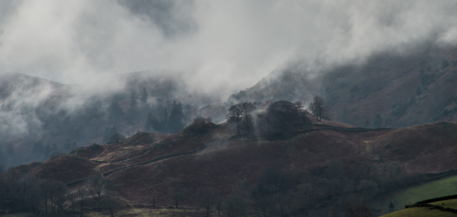 Clouds rising above the hills to the east of Grasmere.