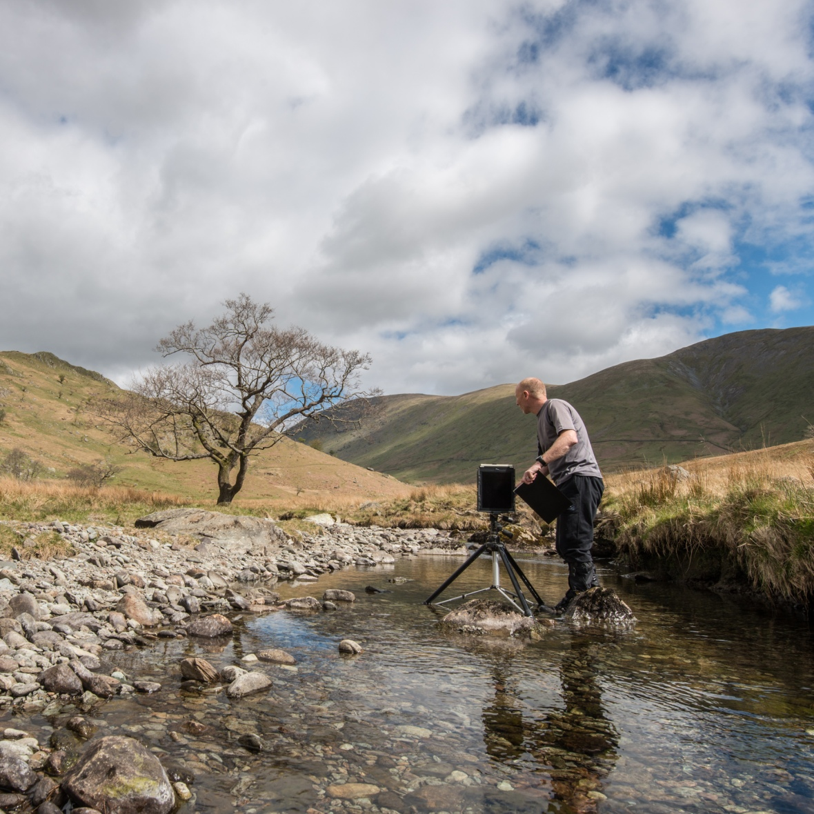 Rob Fraser with a 10x8 Ilford Titan Pinhole camera making an image of the Trout Beck Alder for The Long View