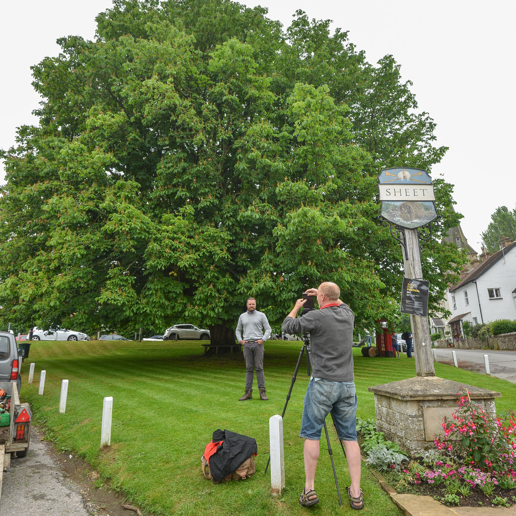 Rob making a large format portrait of Nick Heasman in front of the horse chestnut on Sheet green.